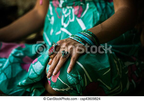 closeup of woman hand practice yoga outdoor sit in lotus