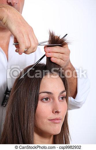 Closeup of woman having an haircut - csp9982932