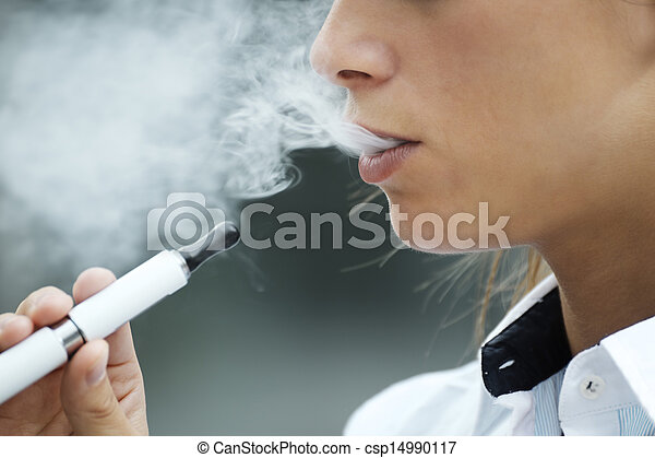 closeup of woman smoking electronic cigarette outdoor - csp14990117