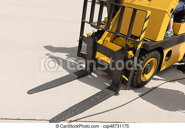 Closeup of yellow forklift truck - csp48731175