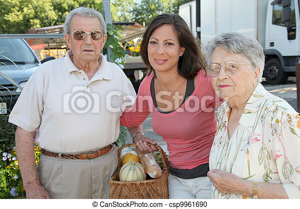 Closeup of young woman with couple of elderly persons - csp9961690