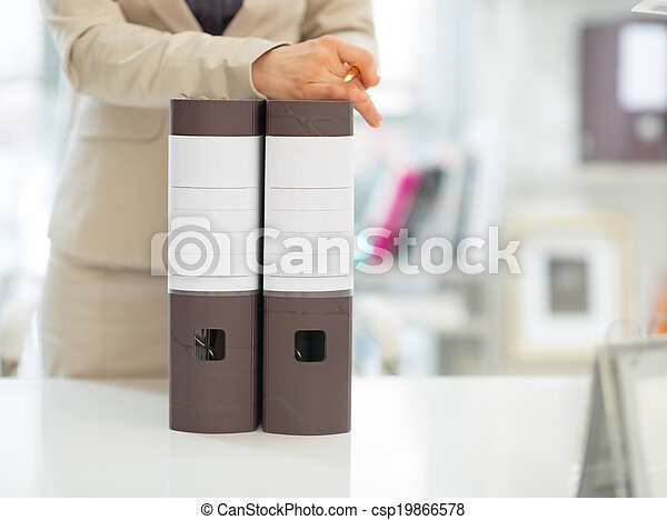 Closeup on business woman with folders - csp19866578