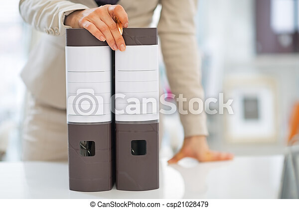 Closeup on business woman with folders - csp21028479