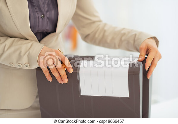 Closeup on business woman with folders - csp19866457