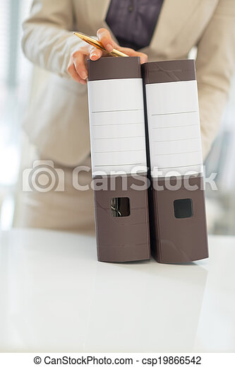 Closeup on business woman with folders - csp19866542