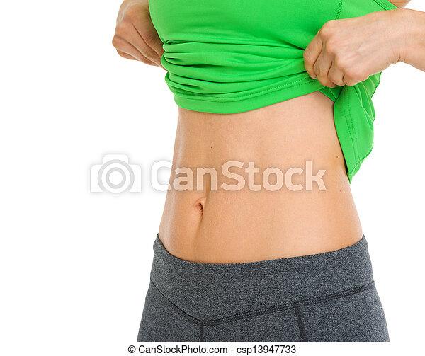 Closeup on tummy of fitness woman - csp13947733