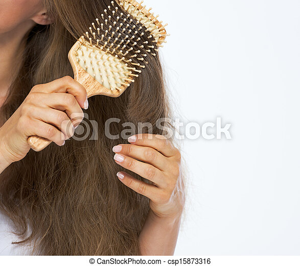 Closeup on young woman combing hair - csp15873316