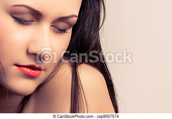 Closeup photo of a young woman - csp9557574