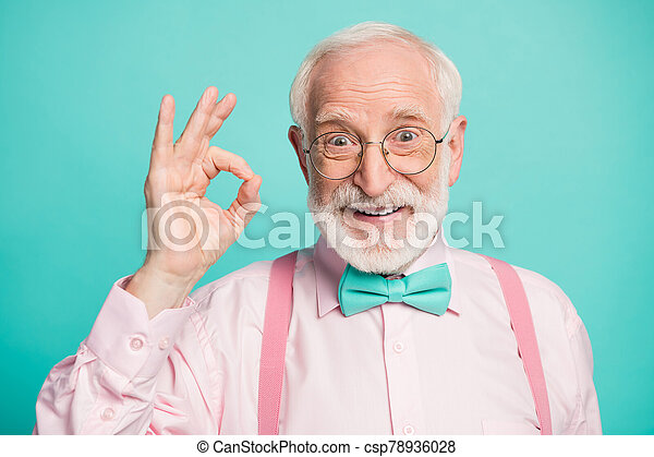 Closeup photo of amazing grey haired grandpa showing okey symbol express agreement wear specs pink shirt suspenders bow tie isolated bright teal color background - csp78936028
