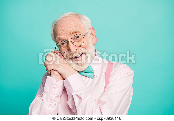 Closeup photo of amazing stylish clothes grandpa affection facial expression arms near ear head overjoyed wear specs pink shirt suspenders bow tie isolated bright teal color background - csp78936116