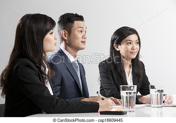 Closeup portrait Chinese Business people having a meeting - csp18609445