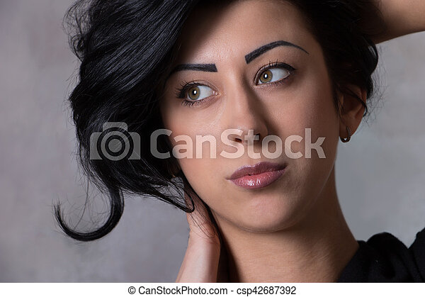 closeup portrait of a beautiful young woman with elegant long shiny hair , concept hairstyle - csp42687392