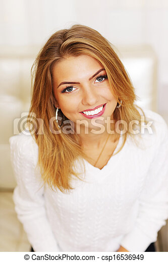 Closeup portrait of a young cheerful woman - csp16536949