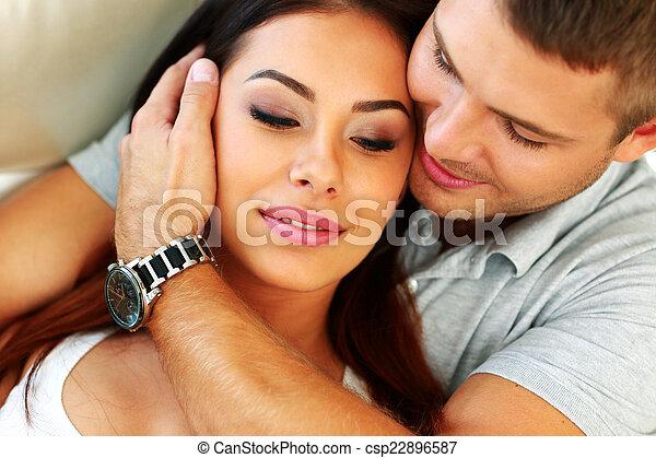 Closeup portrait of a young couple hugging - csp22896587