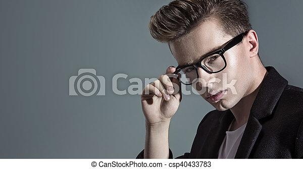 Closeup portrait of a young handsome man - csp40433783