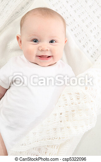 closeup portrait of adorable baby lying on a white blanket - csp5322096