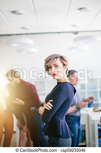 closeup portrait of gorgeous woman with short fair hair looking at the camera - csp59233046