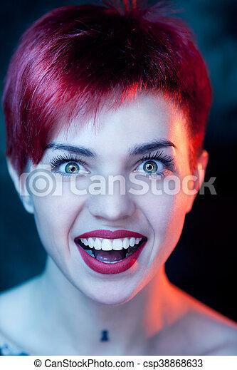 Closeup portrait of surprised beautiful woman - csp38868633