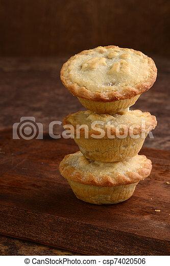 closeup stack of christmas mincemeat pies - csp74020506
