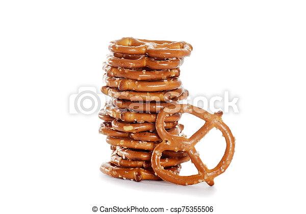 closeup stack of salted pretzels - csp75355506
