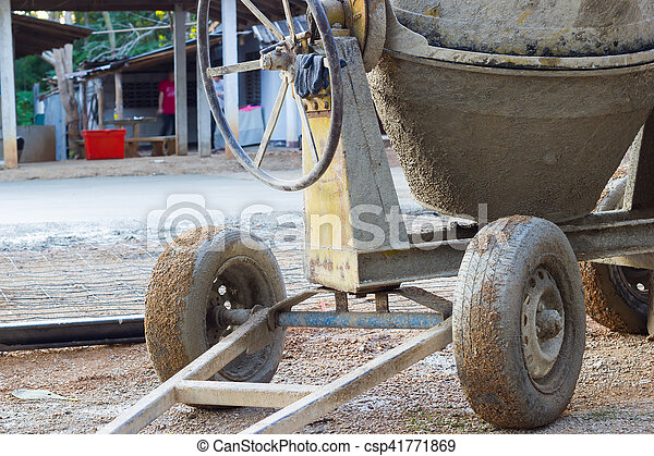 closeup the wheels of cement mixer on the construction site, horizontal photo. - csp41771869