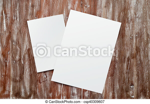 Closeup Two Blank White Paper Sheet Mockup Natural Wood Table Background. Empty Canvas Painted Brown Desk. - csp40309607