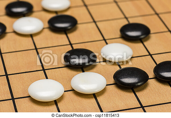 closeup view of stones on a Go board - csp11815413