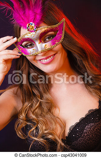 a718dfa47f7f Closeup woman face with carnival mask on dark. Holidays, people and ...