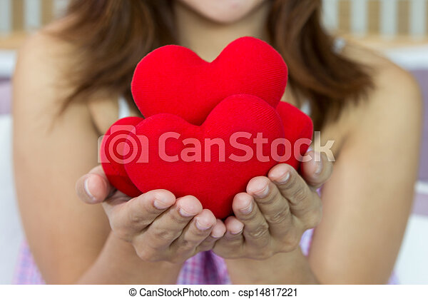 Closeup women happiness with many heart shape in hands - csp14817221