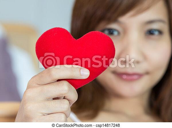Closeup women show with heart shape in hands - csp14817248