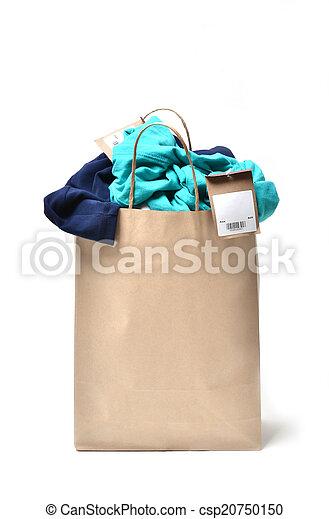 clothes in a shopping bag - csp20750150