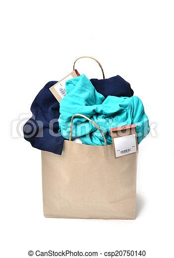 clothes in a shopping bag - csp20750140