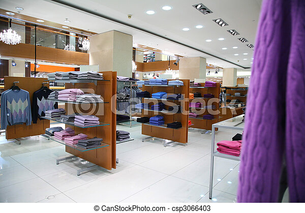 Clothes on shelves in shop - csp3066403
