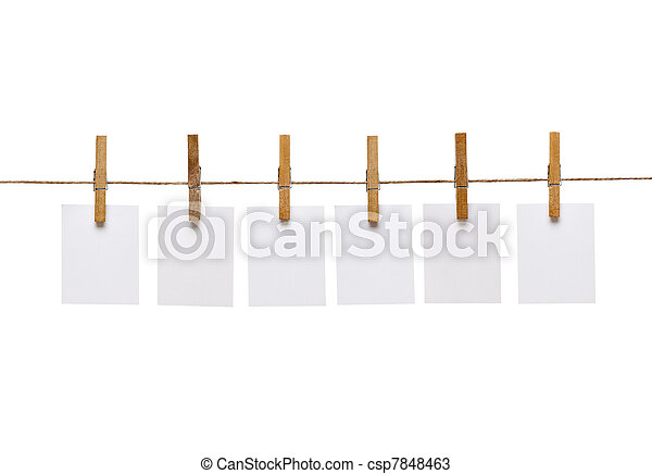 clothes peg and note paper on clothes line rope - csp7848463