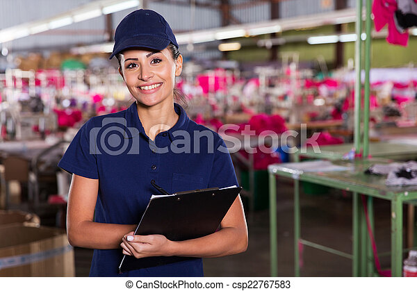 clothing factory supervisor standing in production area - csp22767583