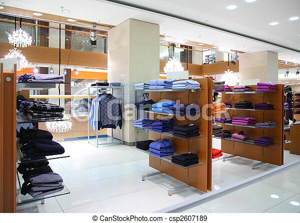 Clothing on shelfs in store - csp2607189