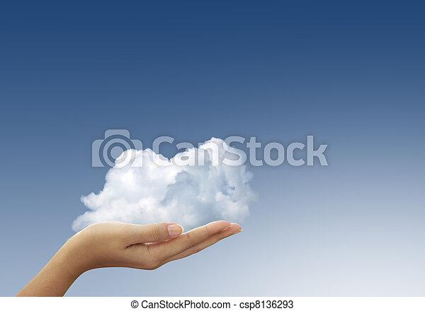 Cloud in woman hands on blue sky - csp8136293
