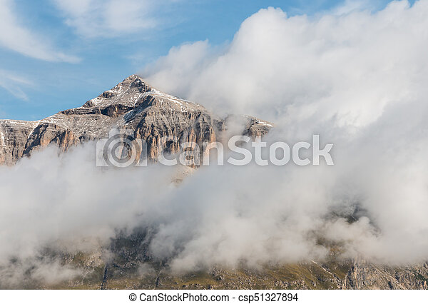cloud inversion around Piz Boe peak in Dolomites - csp51327894