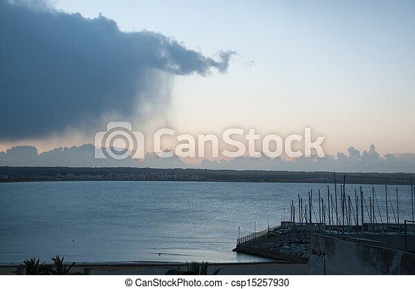 Cloud with rain sweeping out to sea - csp15257930