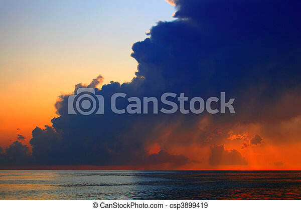 clouds on sea sunset - csp3899419