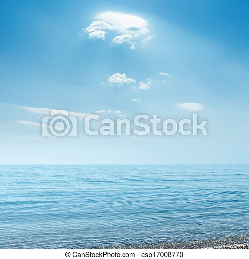 clouds over blue sea - csp17008770