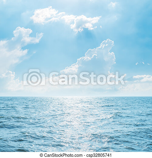clouds over blue sea - csp32805741