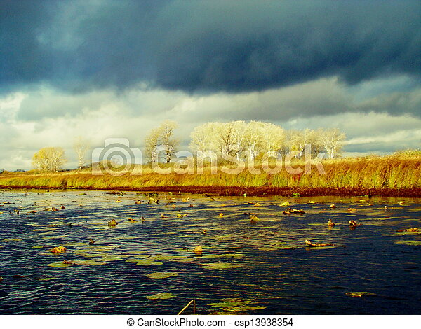 Clouds over the lake - csp13938354