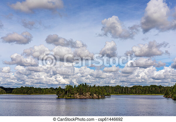 clouds over the summer lake - csp61446692
