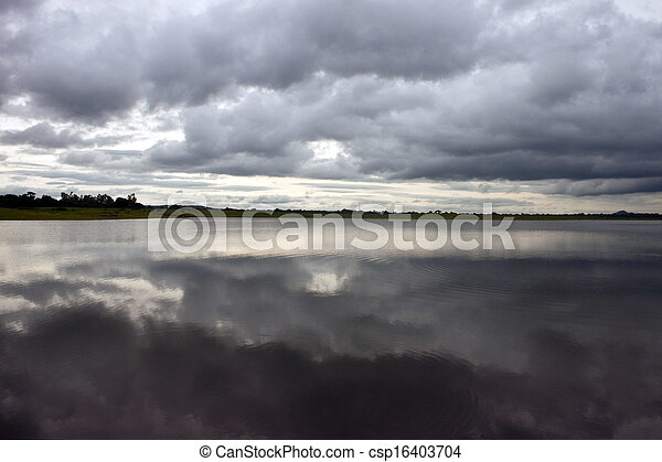 Clouds reflecting in a lake - csp16403704
