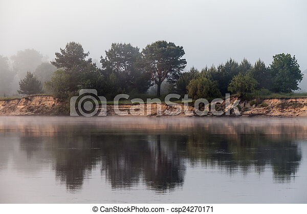 Clouds reflecting in the lake, Ukraine. - csp24270171