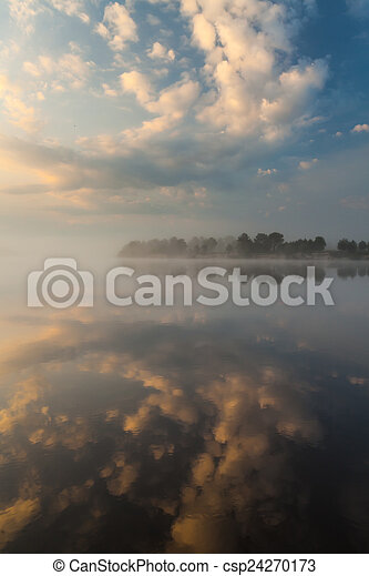 Clouds reflecting in the lake, Ukraine. - csp24270173