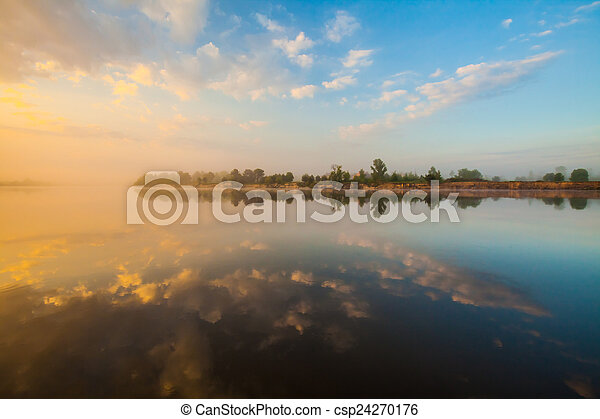 Clouds reflecting in the lake, Ukraine. - csp24270176