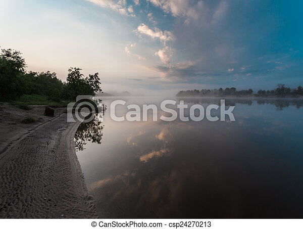 Clouds reflecting in the lake, Ukraine. - csp24270213