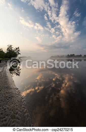 Clouds reflecting in the lake, Ukraine. - csp24270215